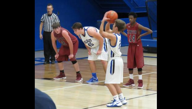Ross Pinnon shoots a free-throw for the A-J Wildcats in a game against Century High School. Photo by Amber Skelton.