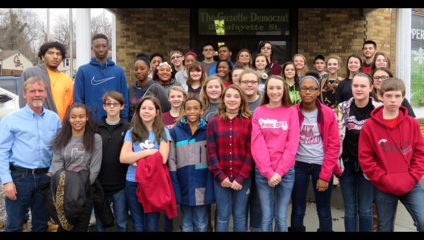 Production manager and publisher of The Vienna Times Lonnie Hinton, front left, gave Century journalism students a tour of the The Gazette-Democrat office in Anna. Photo by Amber Skelton.