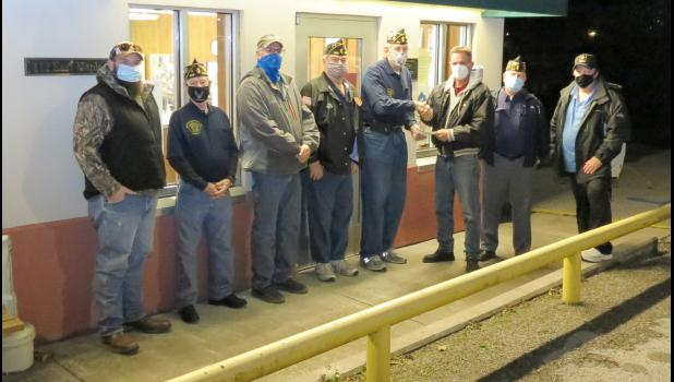 Representatives of the Cobden American Legion post presented a check to village officials on Monday evening, Jan. 4. From left are John Wingate, who has led efforts to develop disc golf courses in Cobden and Anna; Cobden American Legion post representatives Earnie Newton, Harold Blunt, Mark Haddick and Chuck Neal; Cobden Mayor Paul Z. Tomazzoli; and American Legion post representatives Gene Horn and David Stewart.