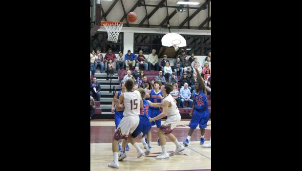 Cobden, in white uniforms, and Egyptian anticipate a rebound after a shot during Monday night's game.