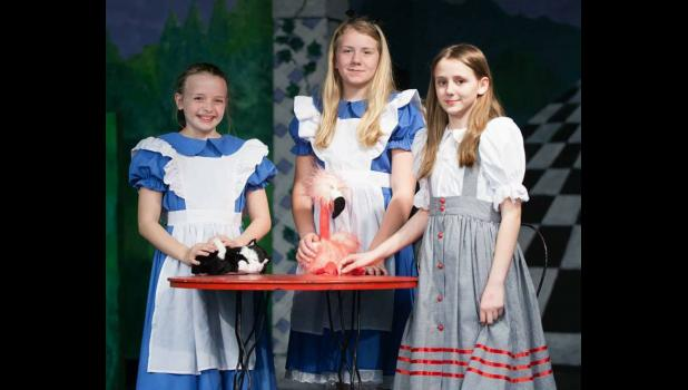 """Scenes from Alice"" cast members Brinley Corbit, Jossilin Needling and Jadden Brimm are looking forward to performing in the play. Photo provided."