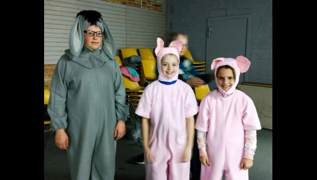 "Cindy Wright created and made the costumes for the play ""Scenes from Pooh."" Eeyore (Anthony Jimenez) and Piglets (Brinley Corbit and Kenzie Stover)  are showing off their costumes. Photo provided."