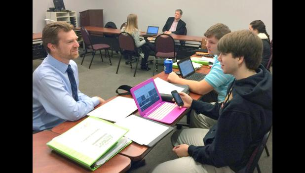Shawnee Community College educational technology specialist Rob Lucas listened as two high school students shared their business ideas during an event held recently in Anna. Shawnee Community College photo.