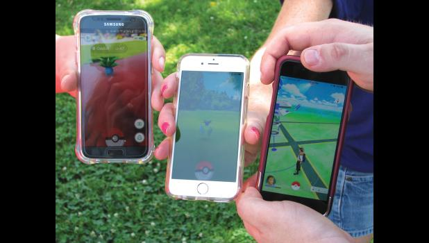 Staff members at Stinson Memorial Library in Anna were using their smartphones one day last week to play Pokemon GO.