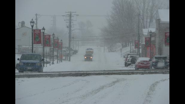 Motorists had a snowy commute on Monday morning in the Union County area. Snow which was falling early in the morning covered area streets, roads and highways. The accompanying picture was taken shortly after 8 a.m. Monday at the intersection of South Main and Davie streets in downtown Anna.
