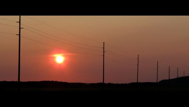 """The mention of a """"molten sunset"""" in something I read recently came to mind when this image was captured while yours truly and his sweetheart went on a pandemic date last Saturday evening. The photograph was taken along the Clear Creek Levee Road."""