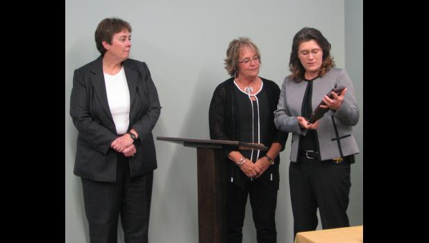 From left are Cindy Barbera-Brelle, the Illinois State Police statewide 911 administrator; retired Union County 911 coordinator Jana Fear; and Col. Kelly Walter of the Illinois State Police and statewide 911 advisory board chairman.