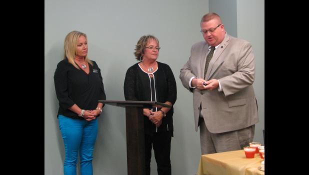 From left are Cindy Wagner, Randolph County 911 administrator; retired Union County 911 coordinator Jana Fear; and Daryl Ostendorf of the O'Fallon Police Department and representing the Illinois National Emergency Number Association.