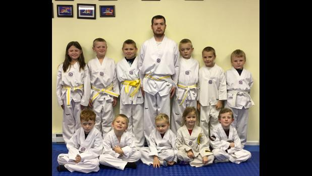 White/yellow belts: In the first row are, from left, Jackson Carter, Levi Hill, Hank Goss, Sophie Hill and Tyler Shoemate. In the second row are Madison Moore, Gavin Moore, Jeffery Lence, Cody Williams, Andrew Bunch, Isaiah Martin and Memphis Morse.