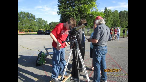 Caidence Britt gazed through a telescope as part of a solar camp held at Egyptian School last week. Photo provided.