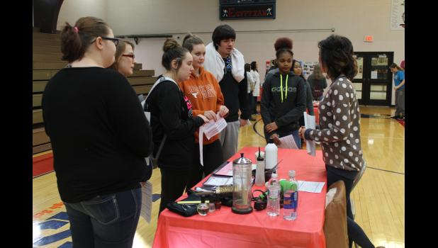 Amanda Gibson talks to students about pursuing a career in cosmetology.
