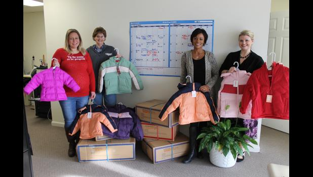 Coats were delivered to the Children's Medical & Mental Resource Network on Wednesday, Dec. 20. From left are Natalie Linton, Shawnna Rhine, Elaina Spalt and Ginger Meyer.