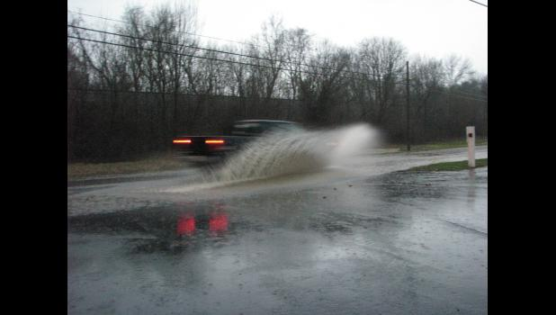 A vehicle made its way through high water on Anna street during heavy rain.