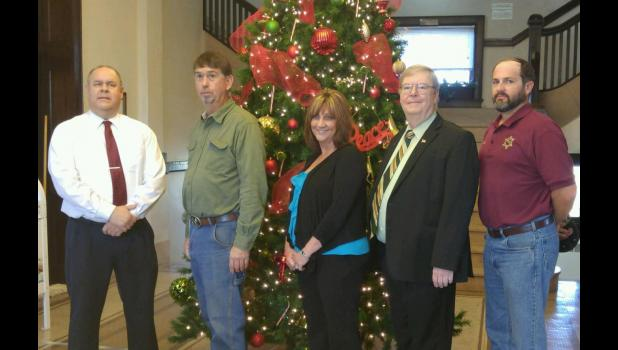 From left are Judge Thurston; David Sharp, who was sworn in as county clerk; Cindy Kennedy, who was sworn in as circuit clerk; Jim Flummer, who was sworn in as state's attorney; and Bryan Curry, who was sworn in as coroner. Sharp, Kennedy and Curry each were reelected in November. Photo provided.