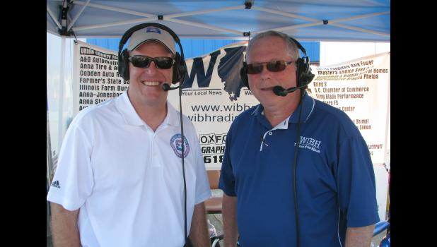 Paul Schimpf, left, a candidate for the 58th Illinois Senate District, stopped by the WIBH tent to talk to Moury Bass during one of the radio station's broadcast from the fairgrounds.