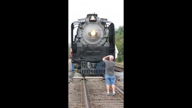 A photographer gets an up-close picture of the steam locomotive.