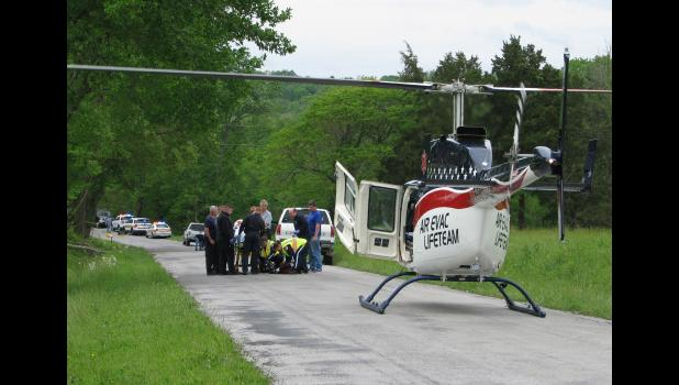 One of the persons injured in a traffic accident Wednesday afternoon, May 3, was air-lifted by helicopter from the scene.