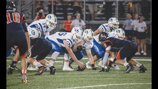 The Wildcats prepare to snap the ball – in the photo are A-J quarterback Bryce Osman, number 14; Aaron Lence, number 56; Caleb Clover, number 6; Austin Dillow, number 50; and Kris Potter, number 73.