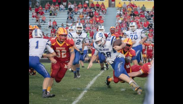 A-J senior Reid Morrison, number 28, tries to elude the Murphysboro defense. Also in the photo are A-J's Noah Craig, a senior, number 70; senior Nate Kisat, number 2; and senior Tyler Smith, number 1.