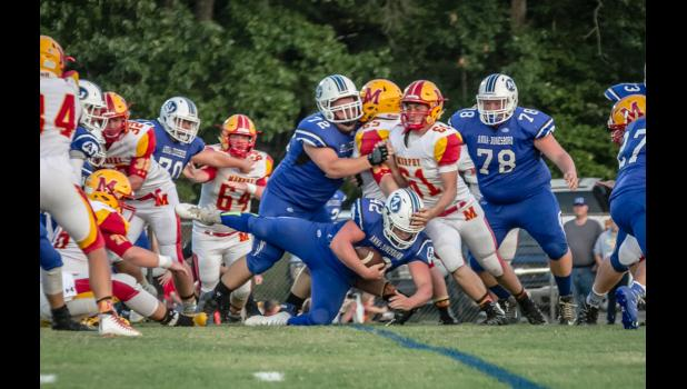 A-J's Jayce Turner, number 42 in dark uniform, crosses the goal line to score a touchdown. Also in the picture are A-J players Noah Craig, number 70, Dylan Cunningham, number 72, and Carsten Christy, number 78.