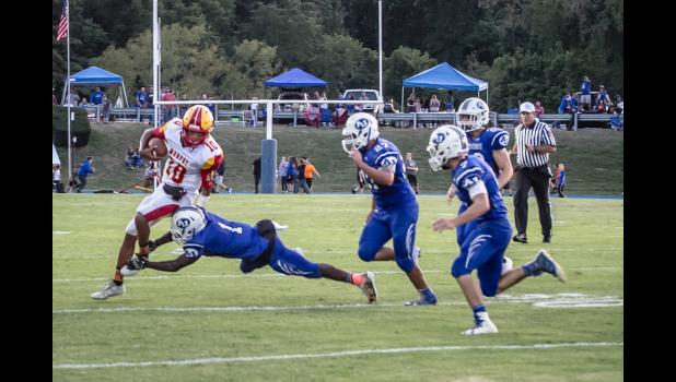 A-J's Arieh Hart, number 1, brings down a Murphysboro ball carrier. Also in the picture are Wildcats Damien Chrisp, number 27, Conner Jerolds, number 7, and Reid Morrison, number 28.
