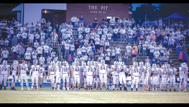 White uniforms and t-shirts were the story at last Friday night's Anna-Jonesboro Community High School football game. A-J had its annual White Out game to help support the work done by the Muscular Dystrophy Association. The Wildcat football squad and its fans wore white for the special occasion. Photo by Tiffiny Dillow for The Gazette-Democrat.