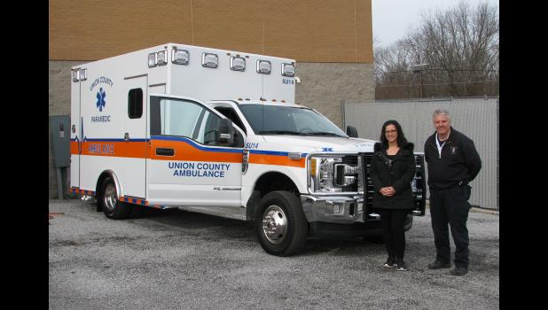 Ambulance service director, assisant director with new unit Union County Ambulance Service director Grant Capel and assistant director Jaime Watkins stand next to the service's newest vehicle.