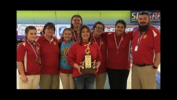 Members and a supporter of the Anna Junior High School girls' bowling team included, from left, Avery Page, Amy Hopkins (coach), Caitlin Ames, Ariel Nekola, Kim Prater (from The Strike Zone in Anna) Madi Hawk, Sara Sinisi and Cary Quick (coach). Photo provided.