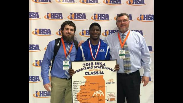 A-J state champion wrestler Arieh Hart, with A-J wrestling team head coach Eric Massey, right, and assistant coach Chase Hargrave, left.
