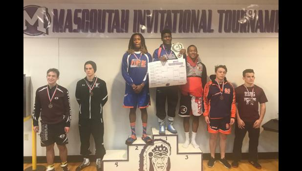 Anna-Jonesboro Community High School's Arieh Hart, middle, won the 152-pound weight class at the 48th annual Mascoutah Wrestling Tournament Dec. 16. Photo provided.