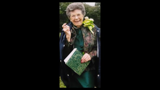 """Barb Bauer portrayed revered teacher Mrs. Ella Jane Pickles Sanders at the Jonesboro Cemetery during a Union County Bicentennial event in 2018. She was wearing a corsage of green orchids and shared a special message: """"Now put that in your little green pipe...with vim, vigor and vitality."""" Photo provided."""