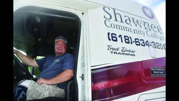 A new automatic truck donated for use by Shawnee Community College truck driving program is already helping one student, Billy Floyd, get on the road to success. Shawnee Community College photo.
