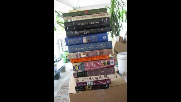 The Leaning Tower of Too Many Books to Read? So many, as a matter of fact, that they caused our house to tilt to one side. Some day, when yours truly has more time on his hands, all of these books will be read. One, oops, make that two, of the books in this stack are signed by the authors.