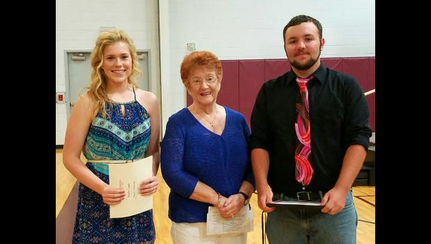 Natalie Taake, Pulaski-Alexander IAHCE chairperson June Badgley, and Levi Jones are pictured at the senior awards banquet at Century High School at Ullin after the students received their $500 scholarships.