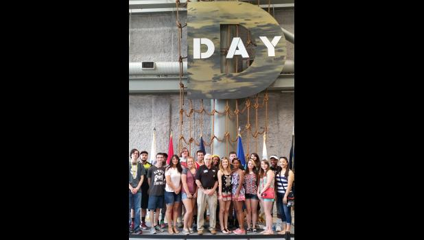 During their visit, Century students toured the National World War II Museum. They posed with their host, Gaston, who is a Vietnam veteran.