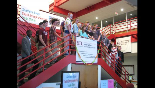 A ribbon cutting was held to formally open a Southern Illinois Youth Entrepreneur Trade Show, which was held Tuesday evening, April 25, at the Dunn-Richmond Economic Development Center at Southern Illinois University Carbondale. Young entrepreneurs from Union, Jackson, Perry and Williamson counties were featured in the trade show.