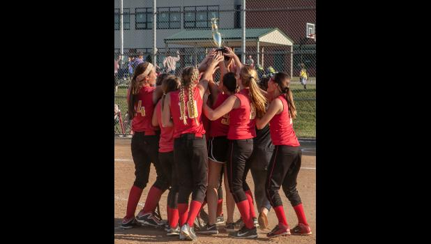 Anna Junior High School softball players celebrate their victory in the regional championship game.