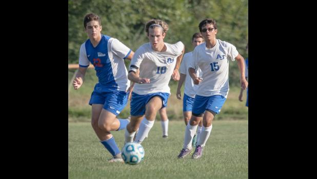 Jaryt Tripp, number 18, and Blake Pena, number 15, in action.