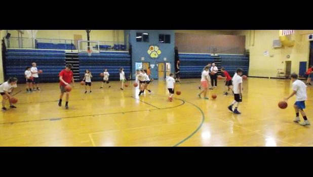 Over 75 aspiring athletes enrolled in this year's Coach Ron's Basketball 101 and Sports Speed Development Camp. The annual summer training event was open to boys and girls grades 2 through 8. Coach Ron Fulenwider has over 47 years of experience in coaching and training young athletes. His summer basketball camp has become an annual tradition for students of the sport. This year's camp also featured Cameron Wright in a coaching role. Wright, a former student of Coach Ron, is a Southern Illinois native and a