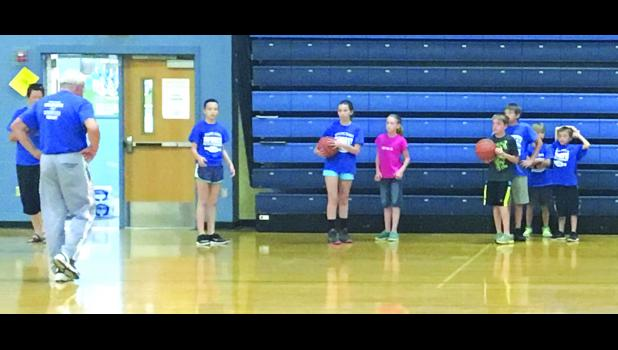 Kids waited for Coach Ron's signal to begin the basketball dribbling relay on Tuesday. Photo by Amber Skelton.
