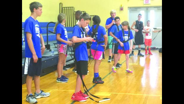 Sixth, 7th and 8th grade campers prepared for a resistance drill Tuesday afternoon. Photo by Amber Skelton.
