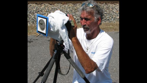 Roger Kobeska of St. Paul, Minn., was setting up interval timing on his camera in preparation for the solar eclipse.
