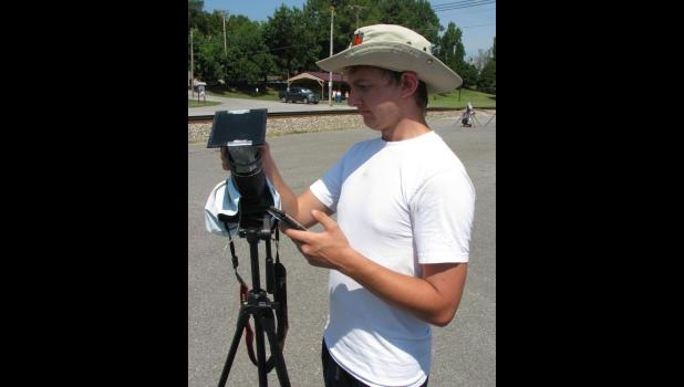 Kaleb McCullough of Cambridge City, Ind., was getting his camera ready for the total solar eclipse Monday in downtown Cobden.