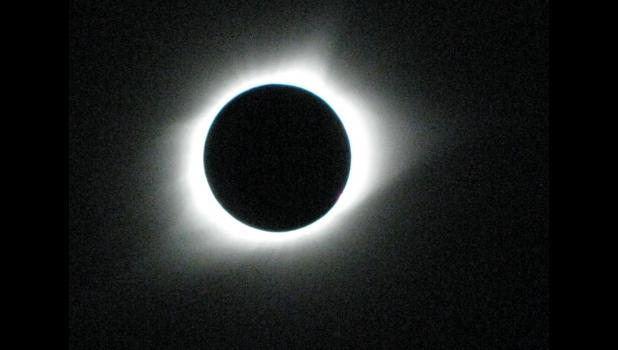 The image shows the solar eclipse during the brief moments of totality over downtown Cobden. Photo by Geof Skinner.