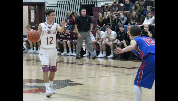 Cobden's John Russell, number 12, directs his teammates as the Appleknockers head up the floor.