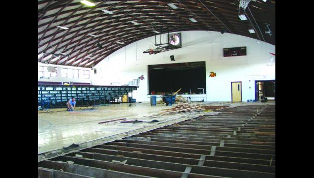 A worker helped to dismantle Cobden High School's gym floor.