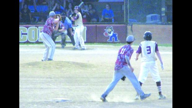 Cobden was at bat and had a runner on second when this picture was taken.