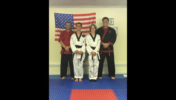 From left are Master Micheal Dockery, Mr. Dillon Greer, Mr. Jacob Cross, and Grand Master Robert Cutrell. Photo provided.