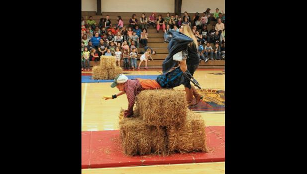 Fifth grade student Collier Morgan climbed over hay bales during the farmer race. Photo by Lindsey Rae Vaughn.