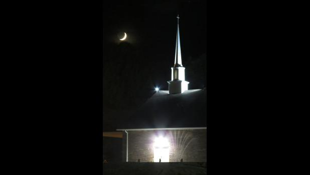 A very bright crescent moon was shining in the night sky over the steeple at the First Baptist Church in Cobden. Didn't even notice the reflection of lights in the lower right hand corner which looked like a water fountain.